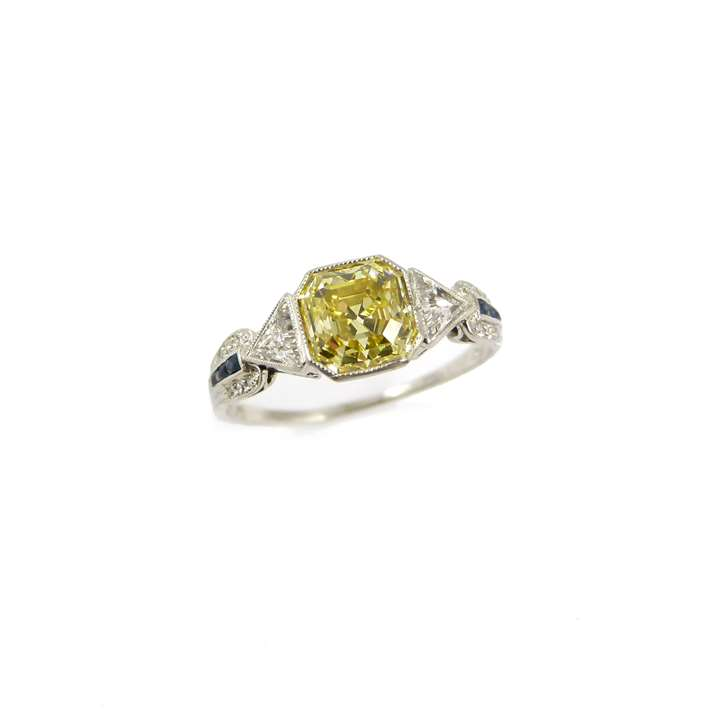 Fancy vivid yellow diamond and fancy cut diamond ring