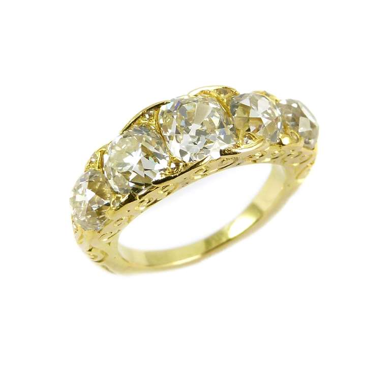 Five stone cushion cut diamond ring