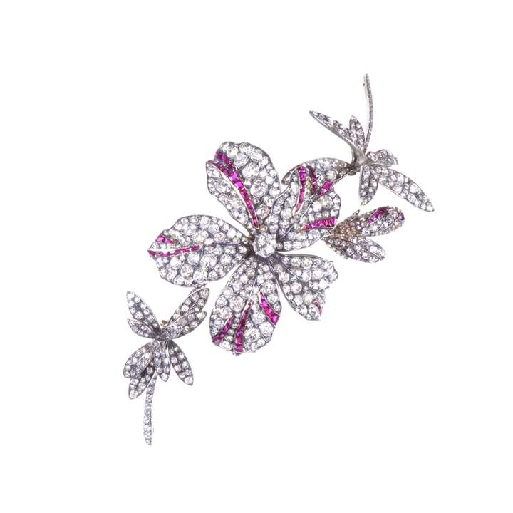 Diamond and ruby floral spray brooch by family repute of Belgian Royal provenance, the corsage centred by a principal five-petal flowerhead