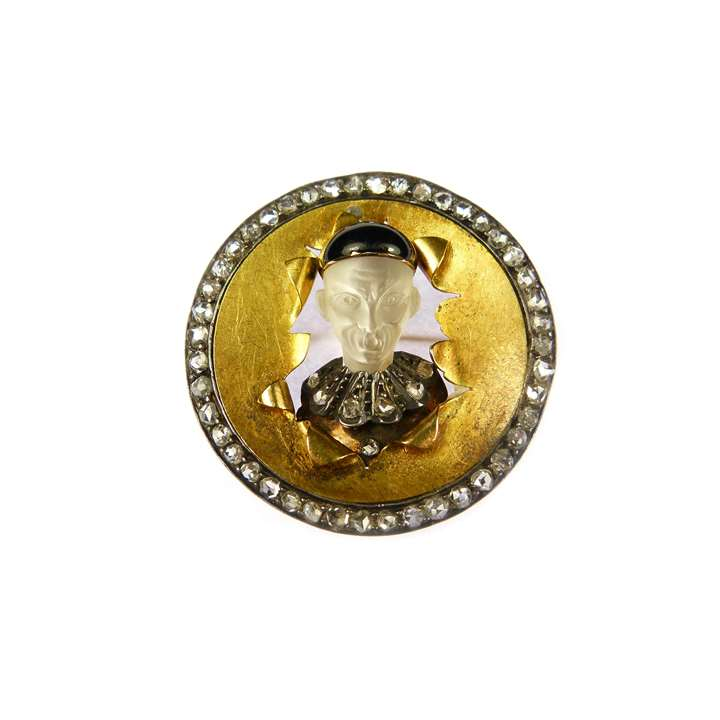 Moonstone, diamond and enamel gold circle brooch, depicting a caricature Chinese man bursting through a drumskin