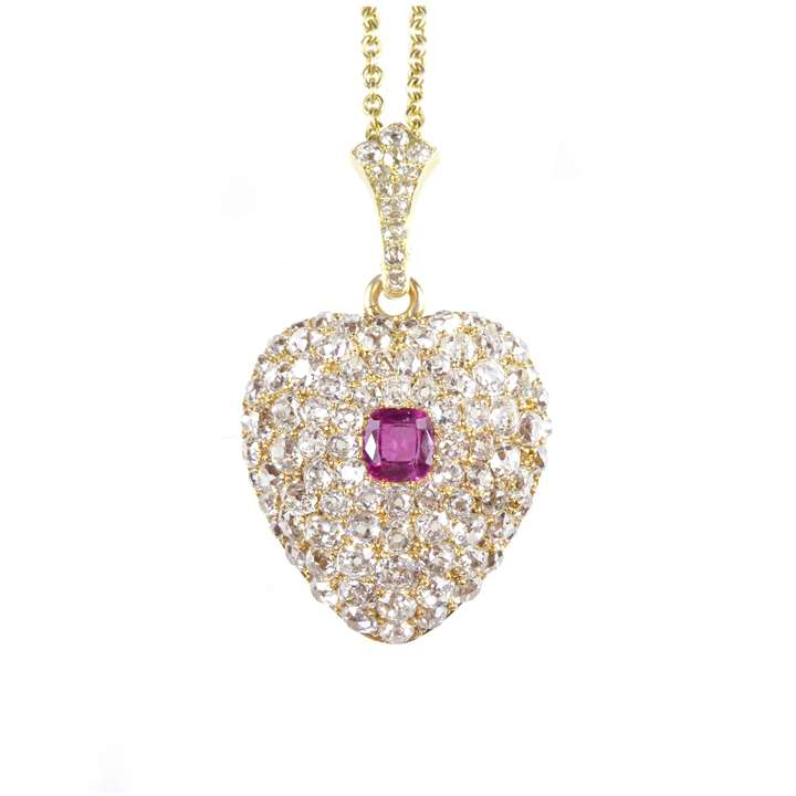 Ruby and diamond heart pendant,  on a later gold chain necklace,