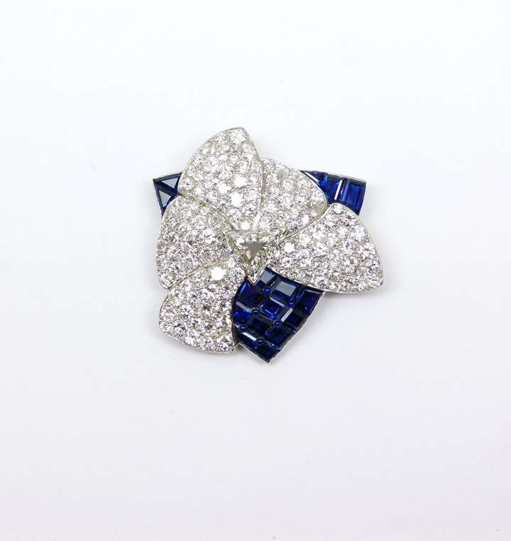 Late Art Deco diamond and sapphire stylised flower brooch