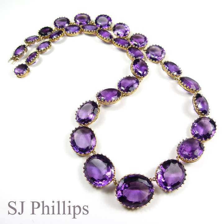 Long 19th century graduated amethyst and gold riviere necklace