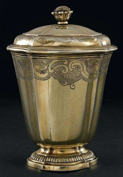 Louis XV silver gilt oval tulip form beaker and cover, with regence decoration and gadroon foot.