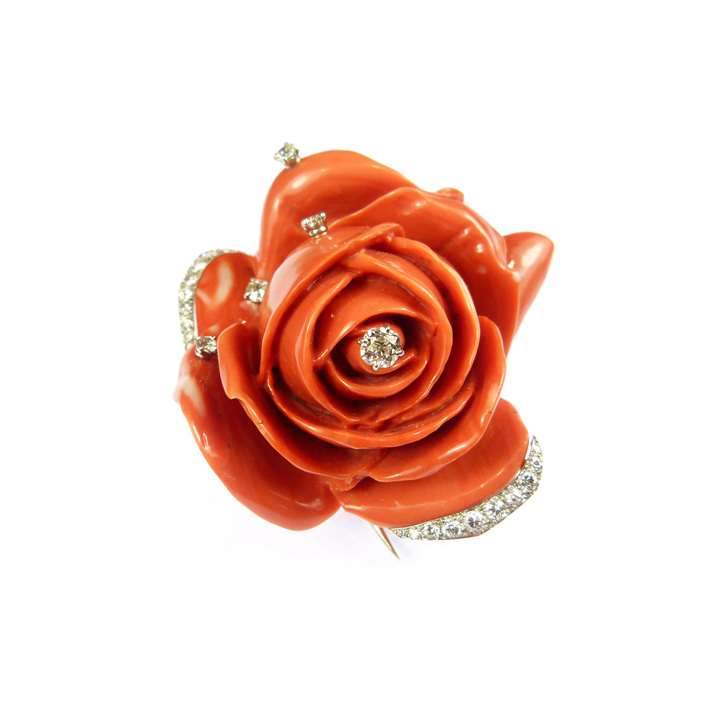 Mid-20th century carved corallium rubrum and diamond rose brooch  naturalistically modelled