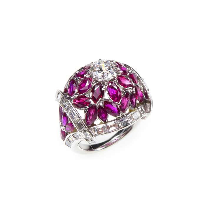 Diamond and ruby bombe cluster ring, with workshop mark for Dumont & Cie