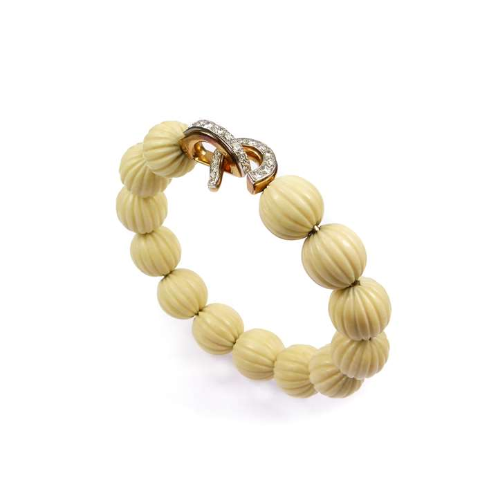 Mid-20th century diamond, gold and fluted white corallium bead bangle