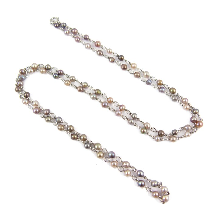 Natural coloured pearl chain necklace, in various shades of brown, grey and black, some iridescent, each with platinum trace link in between