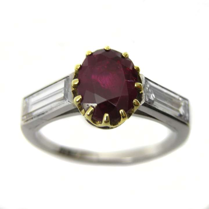 Oval ruby single stone centre and baguette diamond ring