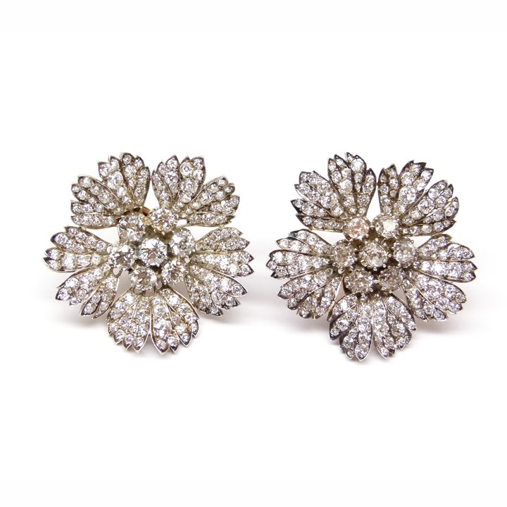 Pair of 19th century large diamond flowerhead clusters, later fitted as earrings