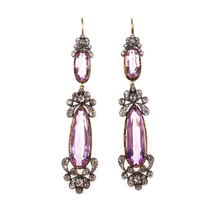 Pair of  pink topaz and diamond scroll cluster pendant earrings