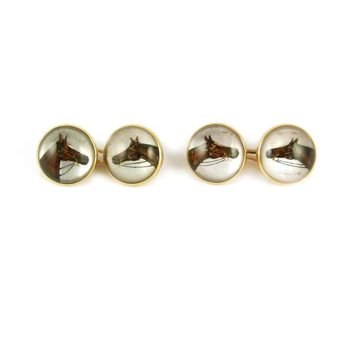 Pair of 19th century reverse painted rock crystal cufflinks with horse's head motifs
