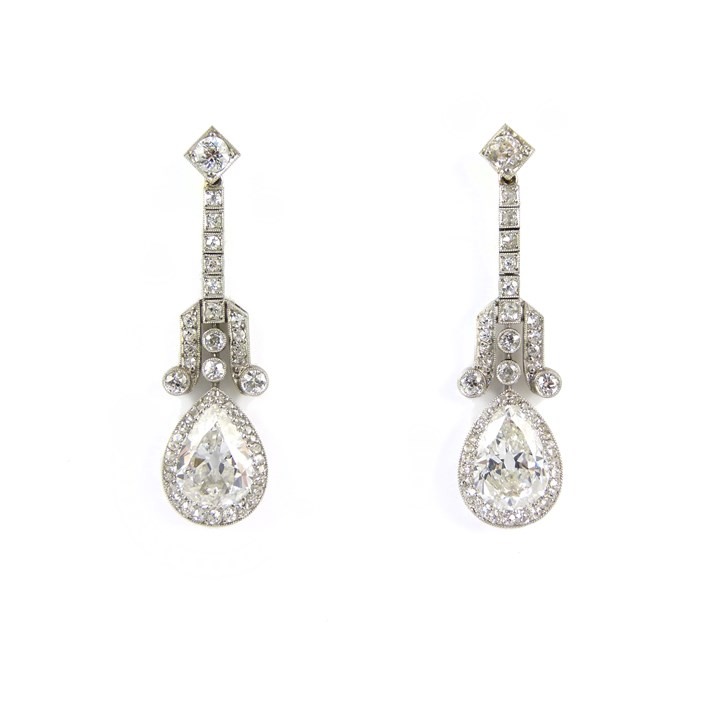 Pair of Art Deco pear shaped diamond cluster pendant earrings