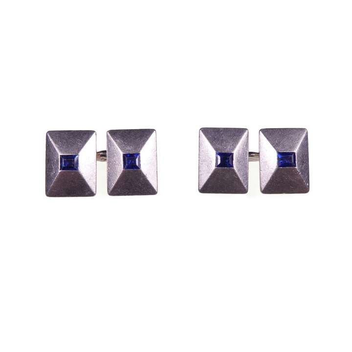 Pair of Art Deco platinum and sapphire rectangular panel cufflinks of low pyramid form