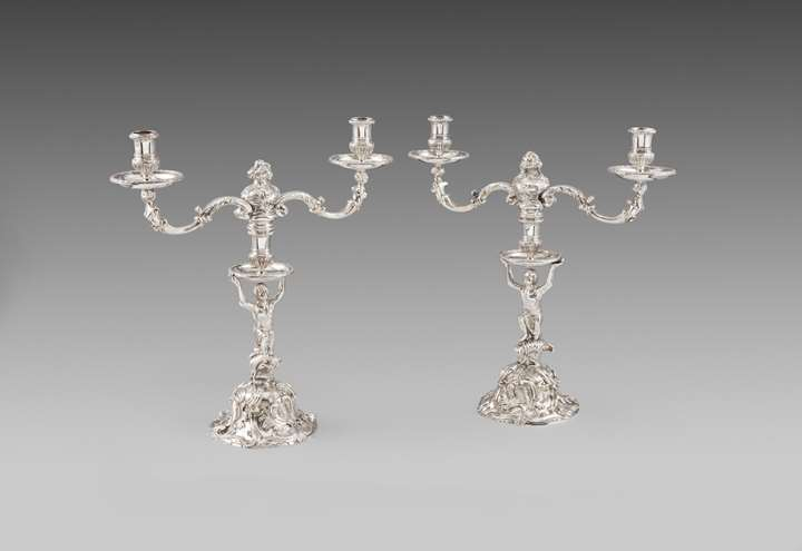 Pair of George II silver two-light candelabra