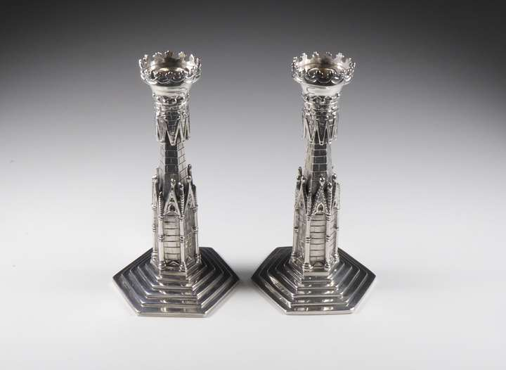 Pair of George III Irish silver candlesticks  in association with Alderman Jacob West designed as Gothic architectural columns,