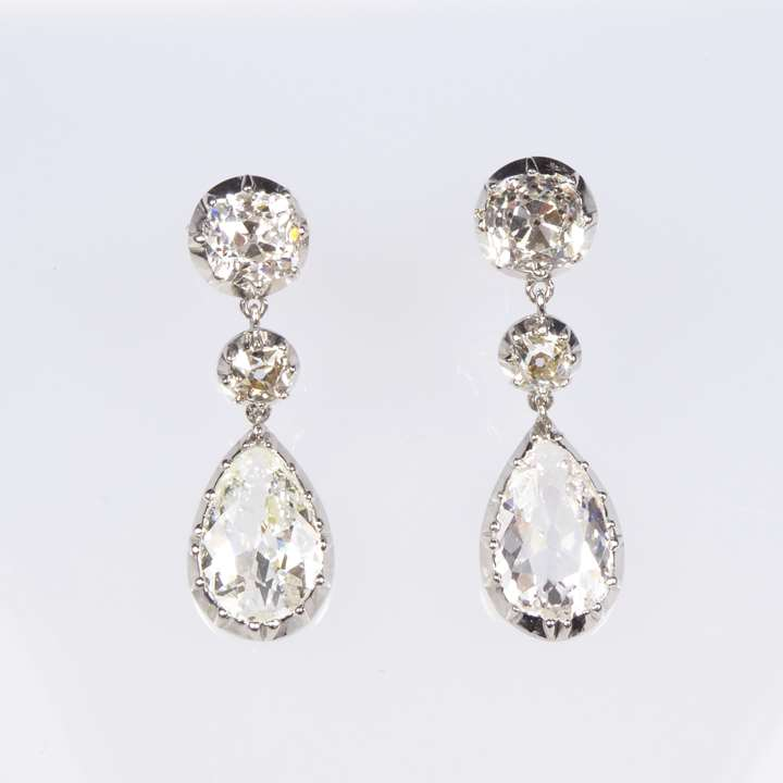 Pair of antique pear shaped diamond and platinum pendant earrings, cut-down collet set
