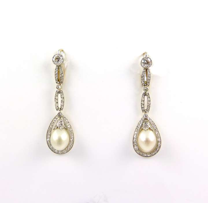 Pair of antique pearl and diamond earrings