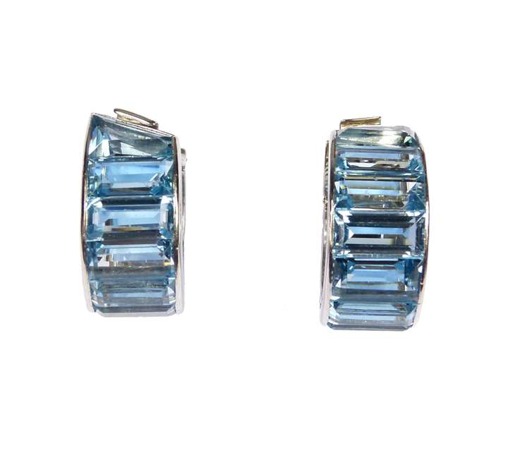 Pair of aquamarine channel set hoop earrings