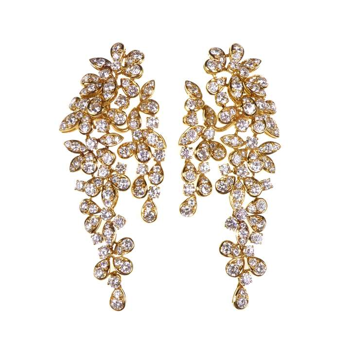 Pair of diamond foliate cluster long pendant earrings by Boucheron, stylised wisteria