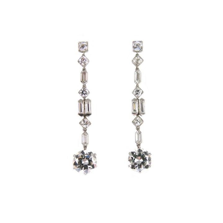 Pair of diamond pendant earrings of geometric design