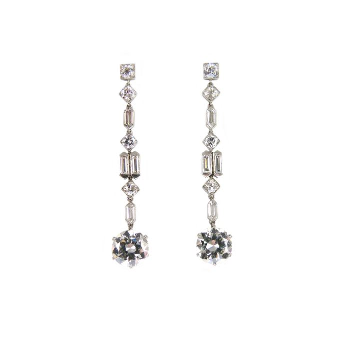 Pair of diamond pendant earrings of geometric design, each hung with a principal round brilliant cut diamond | MasterArt