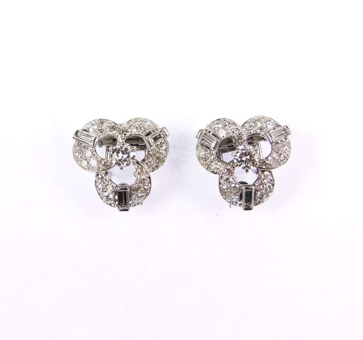 Pair of diamond set trefoil cluster clips by Cartier with later detachable clip earring fittings
