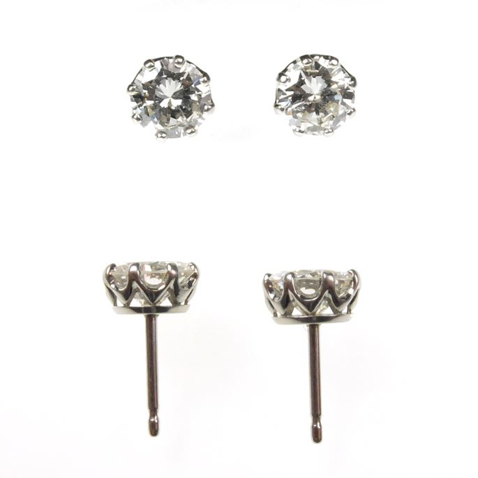 Pair of diamond stud earrings, 1.24cts and 1.22cts, claw set in coronet mounts | MasterArt