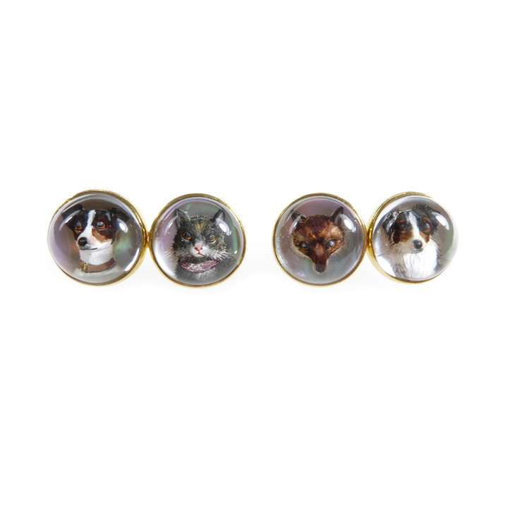 Pair of 18ct gold mounted 'Essex crystal' cufflinks featuring animal heads
