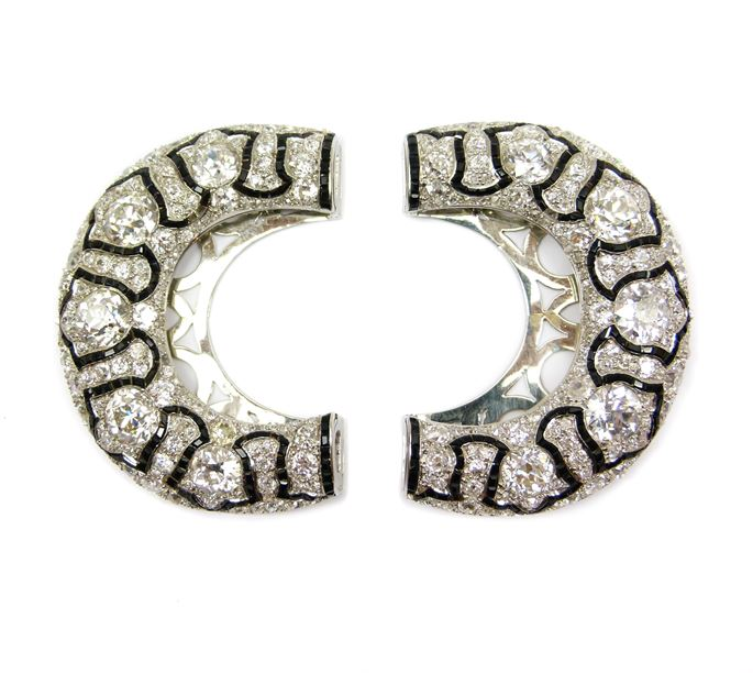 Cartier - Pair of early 20th century diamond and black onyx horseshoe shaped clip brooches formerly hair comb tops | MasterArt