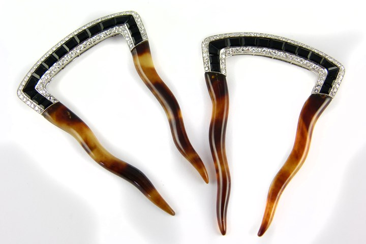 Pair of early 20th century onyx and diamond set hair combs