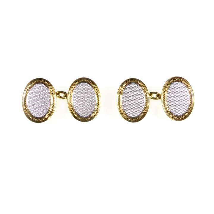 Pair of early 20th century platinum and 18ct gold oval cufflinks