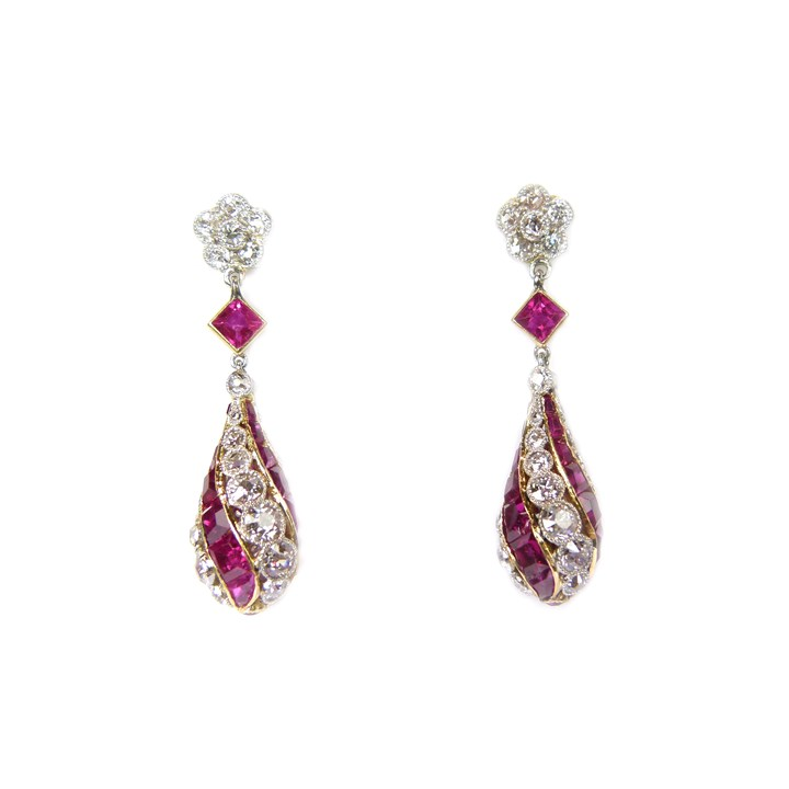 Pair of early 20th century ruby and diamond spiral line pendant earrings