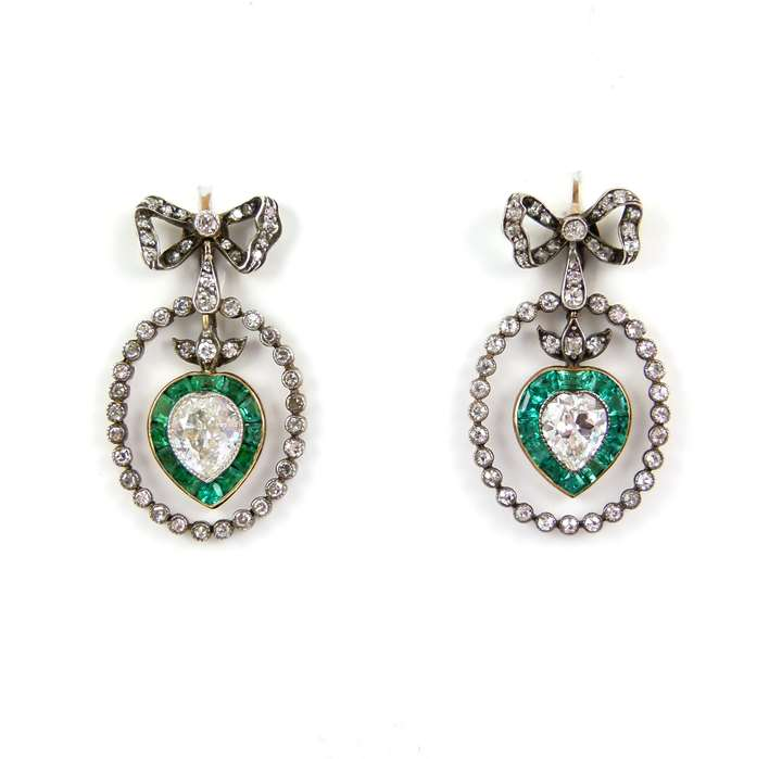 Pair of  diamond and emerald heart cluster pendant earrings from diamond ribbon bow tops