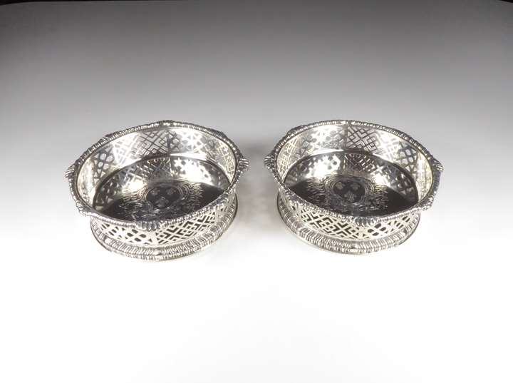 Pair of late George II silver pierced coasters