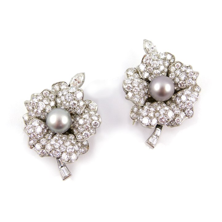 Pair of mid 20th century grey pearl and diamond clip brooches converting to earrings