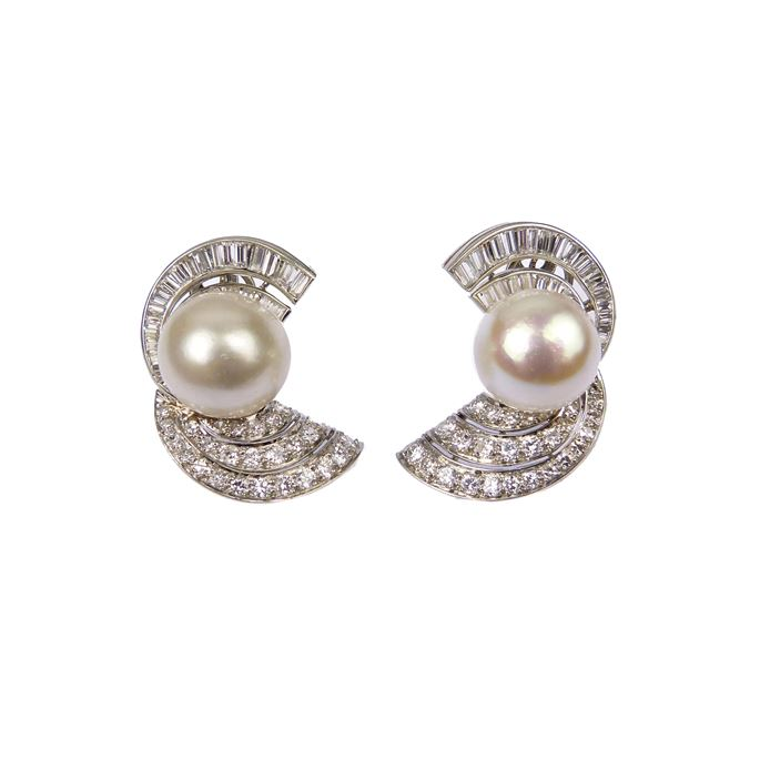 Pair of mid-20th century pearl and diamond scroll cluster earrings, each set with a domed white pearl | MasterArt