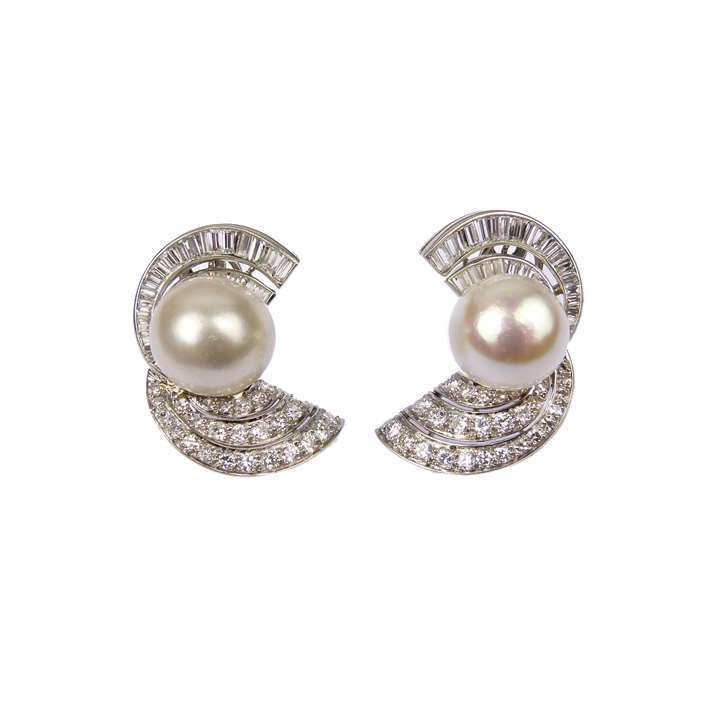 Pair of mid-20th century pearl and diamond scroll cluster earrings, each set with a domed white pearl
