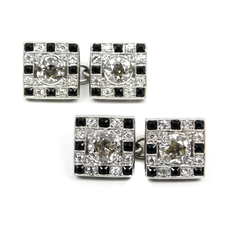 Pair of onyx and diamond square panel cufflinks, open set in platinum, four sides alike