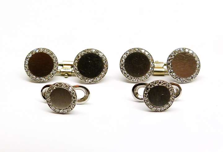 Pair of platinum and diamond cufflinks and two shirt studs