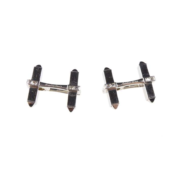 Pair of platinum and diamond hinged 'H' frame stirrup cufflinks