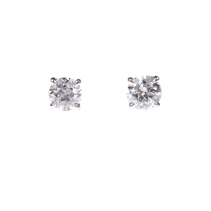 Pair of round brilliant cut diamond stud earrings