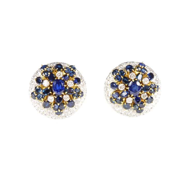 Pair of sapphire and diamond snowflake style cluster dome earrings