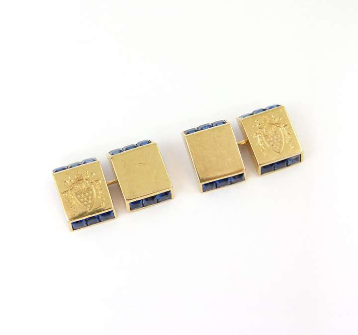 Pair of sapphire set and gold rectangular panel cufflinks with engraved coat of arms