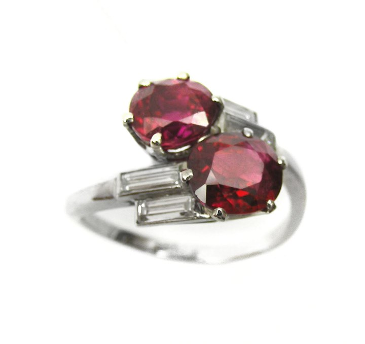 Platinum and ruby 2 stone and baguette diamond crossover ring, open set in platinum