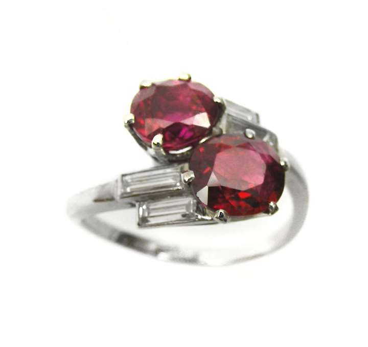 Platinum and ruby 2 stone and baguette diamond crossover ring, open set in platinum.