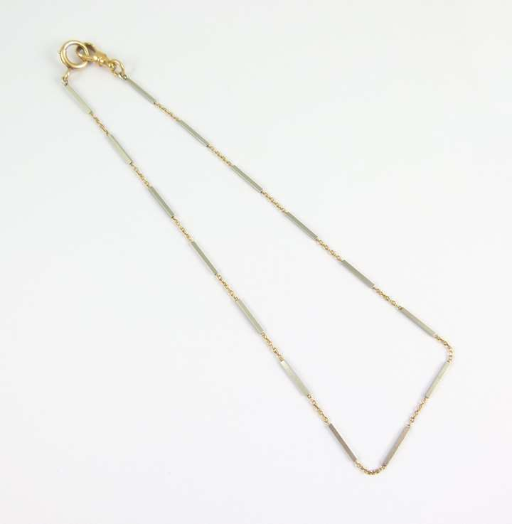 Platinum baton link and gold tracelink chain necklace, the batons of square section