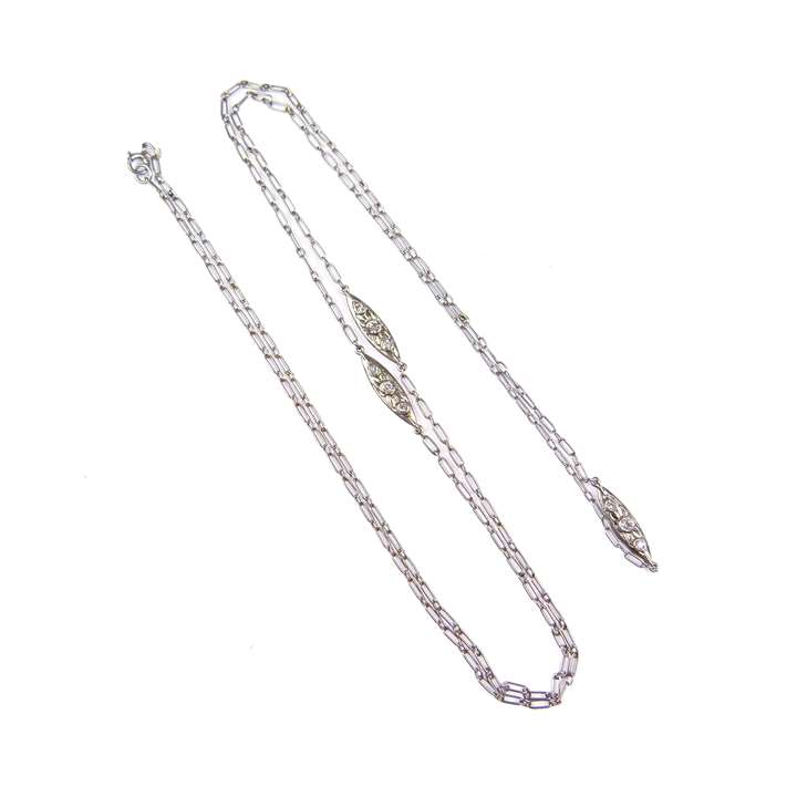 Platinum fetter link long chain necklace spaced by three diamond set cluster links