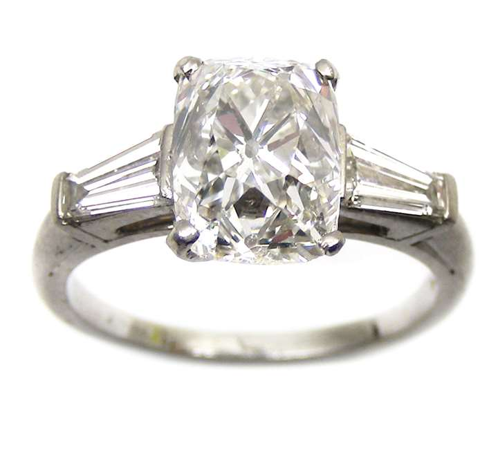 Rectangular cushion cut diamond ring, claw set with a 3.37cts, G SI1 stone