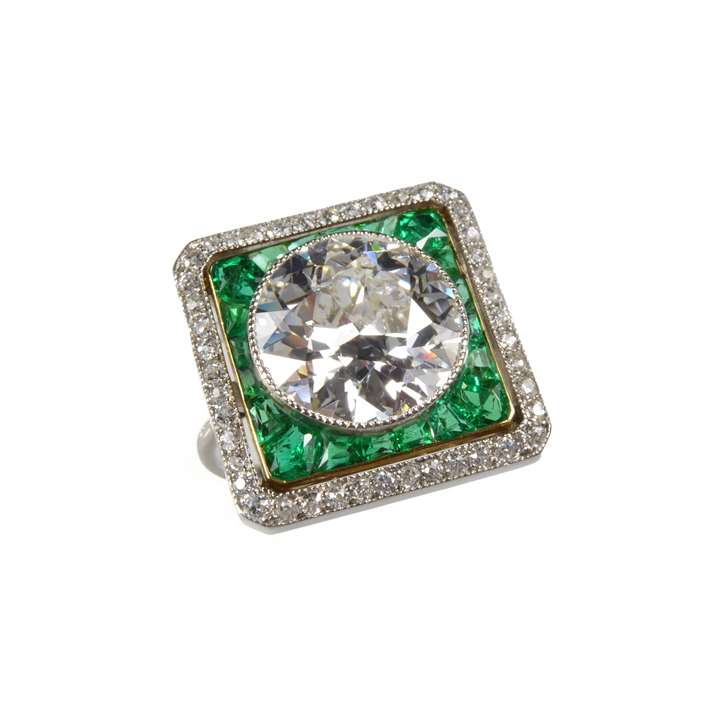 Round brilliant cut diamond, emerald and diamond cluster ring